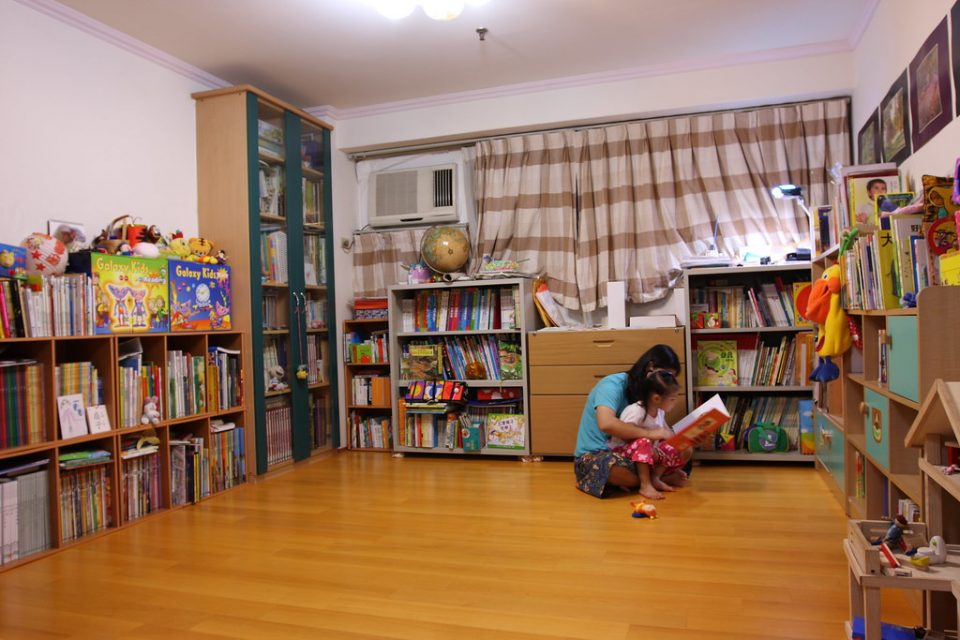Child and Parent Reading in Bedroom